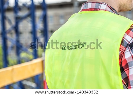 Closeup of a construction manager with a special vest