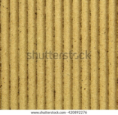 Closeup of a corrugated cardboard background pattern.