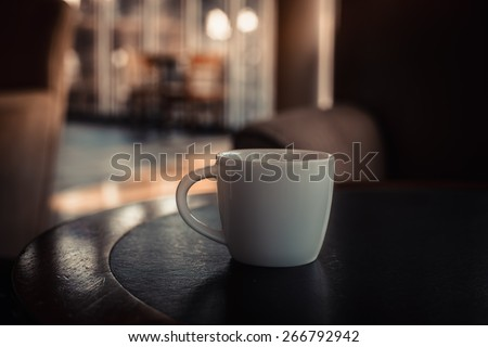 closeup of a cup of coffee at coffee shop - stock photo