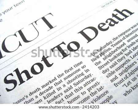 Closeup of a daily newspaper headline that reads SHOT TO DEATH describing a recent crime and homicide.