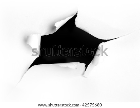 Closeup of a dark hole on white paper - stock photo