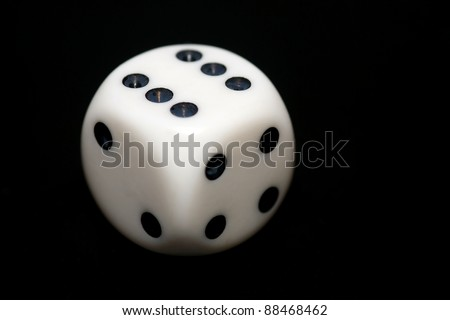 Closeup of a dice with a black background