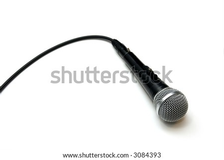 Closeup of a dynamic microphone isolated on white - stock photo