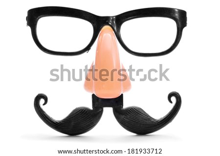 closeup of a fake nose and glasses, with mustache and furry eyebrows - stock photo