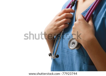 Closeup of a female doctor or a nurse with a stethoscope, focus on the stethoscope on her neck