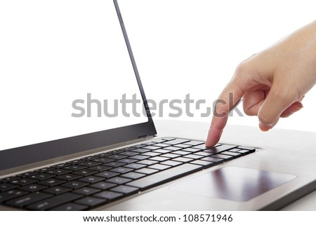 Closeup of a finger pressing enter button of ultrabook laptop computer - stock photo
