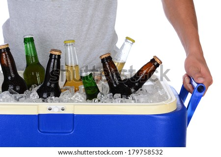 Closeup of a fit young man carrying an ice chest full of beer. Man is wearing a T-shirt top showing torso only. Horizontal format isolated on white. - stock photo