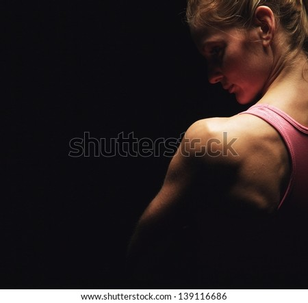 Closeup of a fitness woman's shoulders - stock photo