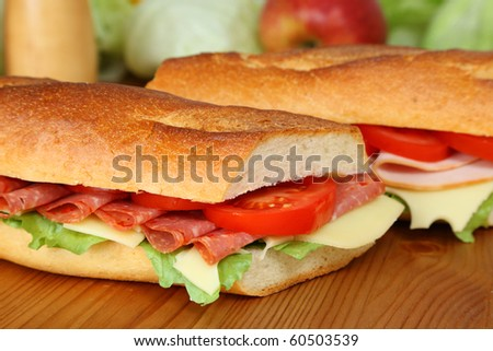 Closeup of a fresh sandwich with salami, swiss cheese and tomatoes - stock photo