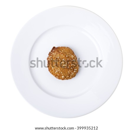 Closeup of a fried cutlet on a plate. Isolated on a white background.   - stock photo