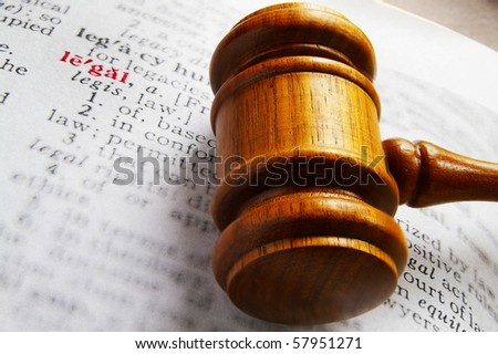 closeup of a gavel and dictionary legal definition - stock photo