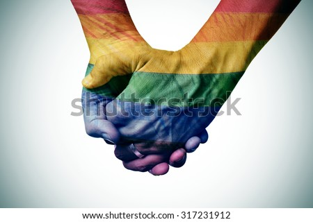 closeup of a gay couple holding hands, patterned as the rainbow flag - stock photo