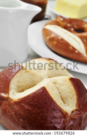 closeup of a german lyre roll on a set table for breakfast - stock photo