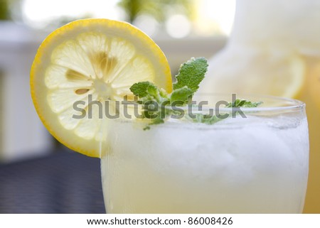 Closeup of a glass of lemonade - stock photo