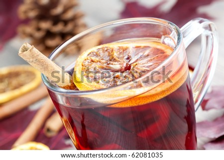 closeup of a glass with hot spiced wine - stock photo