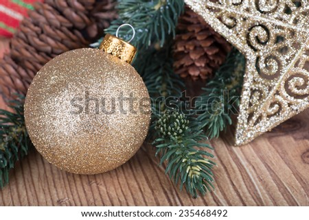 Closeup of a gold Christmas with holiday decorations - stock photo