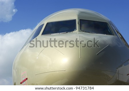 Closeup of a Gold Coloured Airplane Cockpit - stock photo
