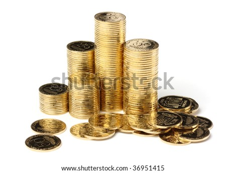 Closeup of a golden coins, isolated over white - stock photo
