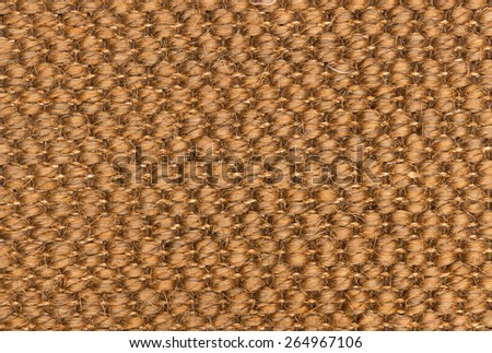 Closeup of a golden woven synthetic carpet for texture or background - stock photo