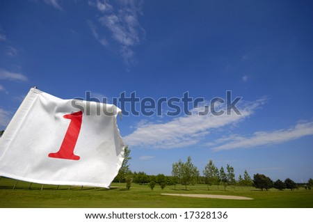 Closeup of a golf flag number one. - stock photo