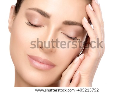 Closeup of a gorgeous natural young woman face with a smooth unblemished complexion and serene expression with eyes closed suitable for skincare and spa concepts, isolated on white with copy space - stock photo