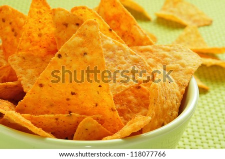 closeup of a green bowl with nachos served as appetizer - stock photo