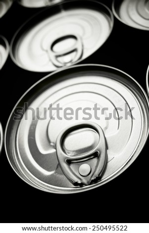 Closeup of a group of aluminium cans. - stock photo