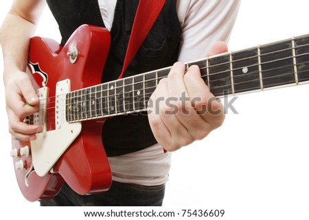 Closeup of a guitarist playing, focus on his hands - stock photo