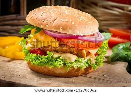 Closeup of a hamburger with chicken and vegetables