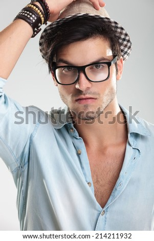 Closeup of a handsome man wearing black glasses and cool hat - stock photo