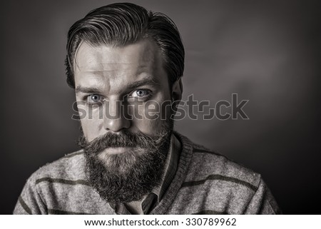 Closeup of a handsome young man with retro look over gray background - stock photo