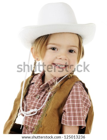 Closeup of a happy little cowgirl.  On a white background. - stock photo