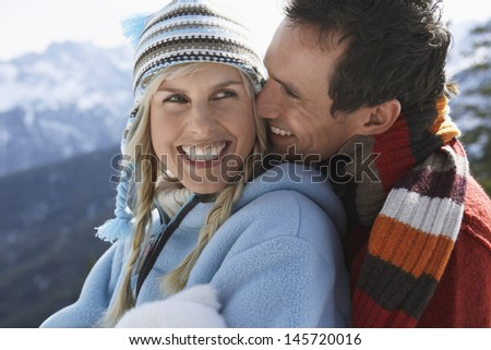 Closeup of a happy loving couple in warm clothing