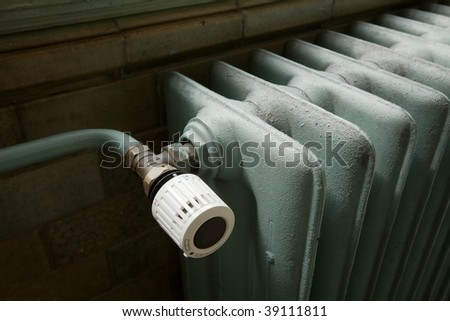 Closeup of a heating radiator in an old building - stock photo