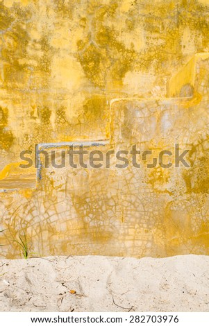 Closeup of a heavily weathered and scratched terracotta surface - stock photo