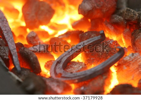 Closeup of a horseshoe in a forge - stock photo