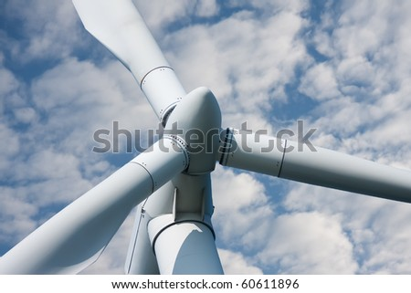 Closeup of a huge windmill against a cloudy sky - stock photo