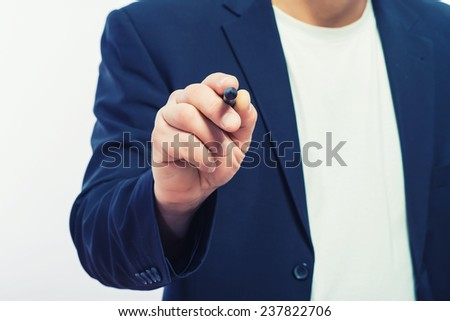 Closeup of a human hand writing with marker; copy space - stock photo