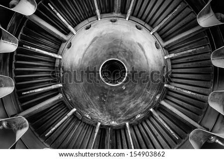 Closeup of a jet engine of an aircraft - stock photo