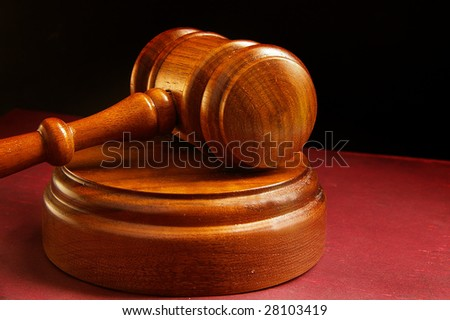 closeup of a judges wooden court gavel - stock photo