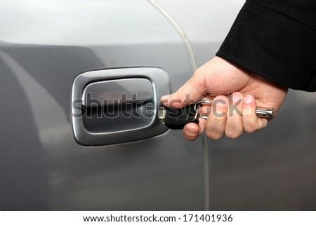Closeup of a key in a car door - stock photo