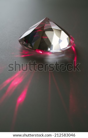closeup of a laser beam impacting on a cut crystal in a diamond