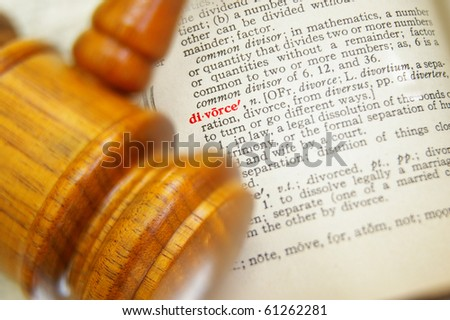 closeup of a legal gavel and divorce in dictionary - stock photo