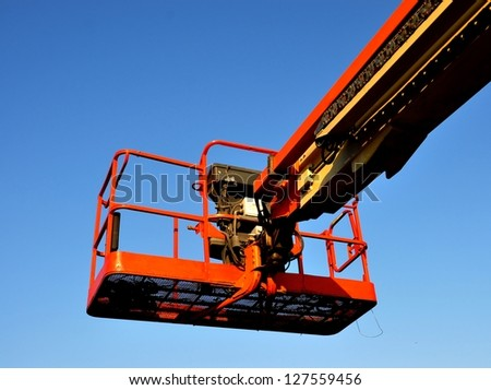 Closeup Of A Lift Bucket On Boom - stock photo