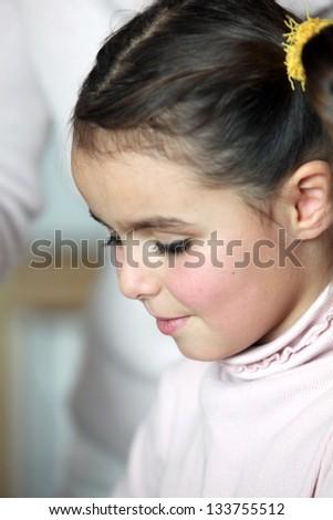 Closeup of a little girl's face - stock photo