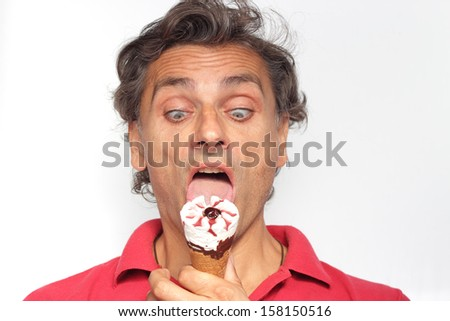 closeup of a man crazy for ice cream - stock photo