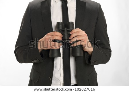Closeup of a man holding binoculars isolated on white - stock photo