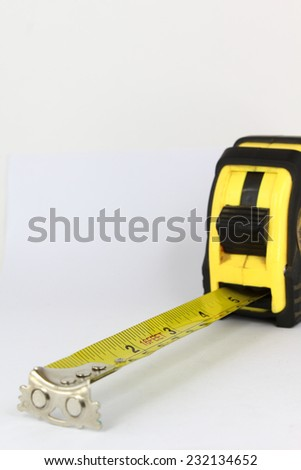 Closeup of a measuring tape isolated on white background. - stock photo