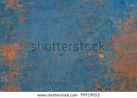 Closeup of a Metal or Steel Plate on the Back of a Truck that is Well Worn and Distressed with Blue Paint that Peeled with Copyspace - stock photo