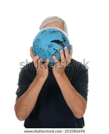 Closeup of a middle aged man preparing to bowl. He is holding the ball in front of his face making him unrecognizable. Vertical format over white. - stock photo